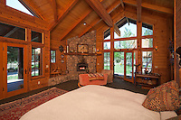Stock photo of bedroom Stock photo of master suite in log home