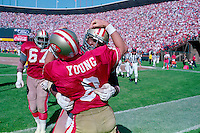 SAN FRANCISCO, CA - Steve Young of the San Francisco celebrates with his teammates in the back of the end zone during a game at Candlestick Park in San Francisco, California in 1992. Photo by Brad Mangin