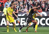 Rafael Teixeira (9) of D.C. United goes against Columbus Crew Danny O'Rourke (5) The Columbus Crew defeated D.C. United  2-1, at RFK Stadium, Saturday March 23, 2013.