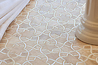 Isidore, a stone waterjet mosaic  shown in Diana Royal and Snow White, is part of the Talya Collection by Sara Baldwin for Marble Systems.