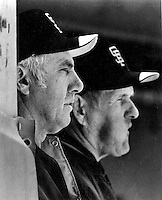 San Francisco Giants manager Jim Davenport and coach Rocky Bridges look out from the dugout..(1985 photo by Ron Riesterer)
