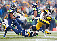 DeAngelo Williams #34 of the Pittsburgh Steelers runs with the ball in the first half past Earl Thomas #29 of the Seattle Seahawks during the game at CenturyLink Field on November 29, 2015 in Seattle, Washington. (Photo by Jared Wickerham/DKPittsburghSports)