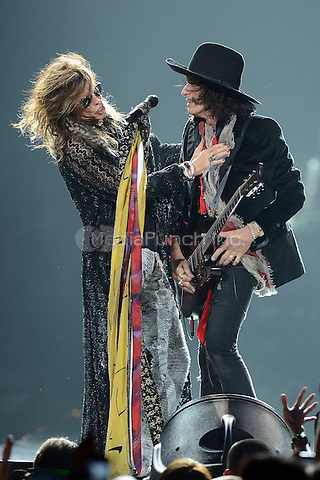 SUNRISE, FL - DECEMBER 09:  Steven Tyler and Joe Perry of Aerosmith perform at the BB&T Center on December 9, 2012 in Miami.  Credit: mpi04/MediaPunch Inc.