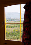 Photo shows the view of the deserted land from inside one of the rainbow-colored cabins at The Cicada Fort that stands on the tsunami-ravaged land of Takata district in Rikuzentakata, Iwate Prefecture Japan on 08 Oct. , 2013. PHOTO: ROB GILHOOLY