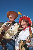 In October, the 22nd Annual Lincoln County Cowboy Symposium brought together chuckwagon crews and cooks from ranches all over the southwest to compete in preparing food for a hungry crowd. Carolyn and Jerry sing cowboy songs for the crowd.