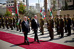 Palestinian Prime Minister Rami Hamdallah and Slovak President Andrej Kiska review the honour guard ahead of their meeting in the West Bank city of Ramallah on March 28, 2017. apaimages/Fadi Arouri/Pool