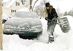 Sentinel/Dan Irving.Allison Schumaker digs out her car in the driveway of her home on 21st Street Saturday morning following heavy snowfall in the region Friday night..(1/22/05).