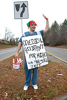 Jeff stands at Freedom Parkway in Atlanta, Georgia trying to get a job. He was recently laid off as a medical assistant and was desperate for a job. He had resumes in his bucket and was handing them out to people passing in cars.