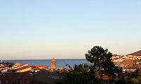 Town and sea, with the bell tower of Eglise Notre Dame des Anges, Collioure, France. Picture by Manuel Cohen.