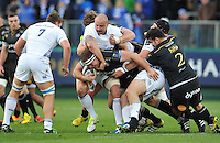 Henry Thomas of Bath Rugby is tackled by Hayden Triggs of Leinster Rugby. European Rugby Champions Cup match, between Bath Rugby and Leinster Rugby on November 21, 2015 at the Recreation Ground in Bath, England. Photo by: Patrick Khachfe / Onside Images
