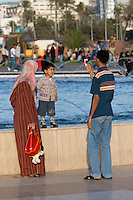 Tripoli, Libya, North Africa - Modern Libyan Family in Public Park near the Green Square, downtown Tripoli.  Father Taking Picture.