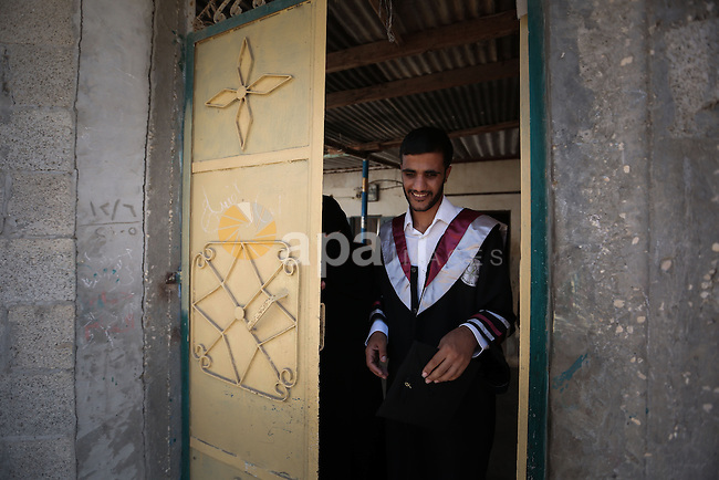 Fadi al-Shami, 21, a Palestinian blind youth, leaves his home to attend the graduation ceremony at his family home in Central Gaza Strip on Aug 17, 2013. al-Shami lost his sight after he was injured by an Israeli airstrike next to his family home at al-Musaddar village in central Gaza Strip during the Gaza–Israel conflict in 2006. Photo by Mahmoud Hamda