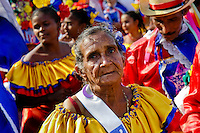 An old Colombian woman, a former Miss Colombia, dances during the Carnival in Barranquilla, Colombia, 27 February 2006. The Carnival of Barranquilla is a unique festivity which takes place every year during February or March on the Caribbean coast of Colombia. A colourful mixture of the ancient African tribal dances and the Spanish music influence - cumbia, porro, mapale, puya, congo among others - hit for five days nearly all central streets of Barranquilla. Those traditions kept for centuries by Black African slaves have had the great impact on Colombian culture and Colombian society. In November 2003 the Carnival of Barranquilla was proclaimed as the Masterpiece of the Oral and Intangible Heritage of Humanity by UNESCO.