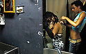 A Palestinian helps an Israeli drag queen prepare backstage  in a gay club in Jerusalem--where the only wall between the people is a dressing room..