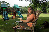 NWA Democrat-Gazette/JASON IVESTER --07/10/2015--<br /> Keri Earwood; photographed on Friday, July 10, 2015, in her favorite place - the backyard of her Rogers home