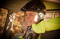 A female mountain biker smiling.