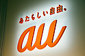 "January 16 2012, Tokyo Japan - The logo of ""au"" is reflected on a wall during a company presentation in Tokyo on Monday, January 16 2012. KDDI released a new pricing plan with discounts of up to nearly 30 percent on smartphone charges from March 1. (Photo by Koichi Mitsui/AFLO)"