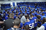 Head coach Mike Holcomb prays with his team before its game against the Morgan County Cougars on Friday, Oct. 14, 2011 in Jackson, Ky. The game was senior night and the last regular season home game for the Bobcats. | Photo by Taylor Moak