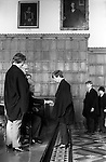 Threepenny Day. February 27th. Eton near Windsor Berkshire, England 1975.<br /> <br /> In 1514 Mr Robert Rede of Burnham near Eton left in his Will a sum of money that gave each boy in College 2d to attend his obit service and annual requiem.  He stipulated that his and his wife&rsquo;s memory shall be &ldquo;recalled yearly, while the world shall endure.&rdquo; Provost Lupton left in his Will dated 1535 a further 1d for a like purpose and to help improve the boys food. In Lupton&rsquo;s Will he also bequest a further 2s 8d, to succeeding Provosts, other members of staff received 1s 4d and less depending on status.  The scholars still received the 1d in a threepenny piece, the other 2d being from the gift of Provost Bost who succeeded Lupton.<br /> <br /> Lupton was an English ecclesiastic, lawyer-cleric, chaplain to Henry VII and Henry VIII and Provost of Eton from 1502-1535. (The chairman of Eton&rsquo;s governing body.) The annual Threepenny Day distribution takes place after lunch in the College Hall on the anniversary of his death. <br /> <br /> After lunch starting with the lowest boy, there are seventy Collegers, known as Kings Scholars, these are boys who have passed the College Election examination and have been awarded a scholarship line up to receive a threepenny piece. Kings Scholars are distinguished by their black gowns, and have the initials KS attached to their surname on all school lists.  The other boys at the school, more than 1200 of them, are known as Oppidans. They dine in the College Hall alone, and play the winter term wall game for five years, whereas Oppidans play usually, only for one year.  <br /> <br /> With the introduction of decimal coinage in 1972, and the abolition of the threepenny piece. Provost Caccia bought up large stocks of redundant coins to ensure continuation of this custom. The Captain of the School is entitled to any threepenny pieces left over owing to absentees. <br /> <br /> The Captain of School, Provost Harold Caccia