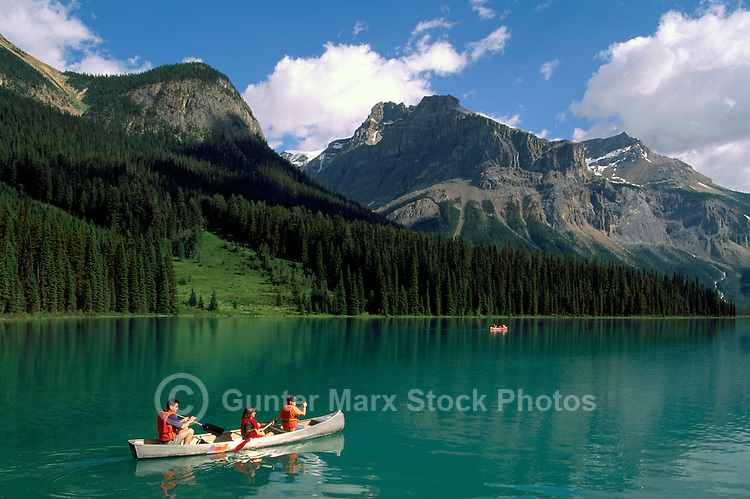 Canoeing on Emerald Lake, and President Mountain (3138 metres / 10,295 feet high), in Yoho National Park, in the Canadian Rockies, British Columbia, Canada, in Summer
