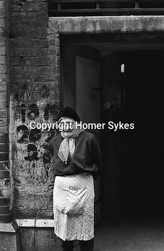 Peabody Housing Estate. Tower Hamlets Whitechapel east London UK 1975. Elderly woman outside her home.