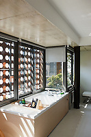 Privacy in the bathroom has been maintained with exterior wooden screens and simple roller blinds