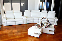 Obelli Design custom built white leather couch with matching table.
