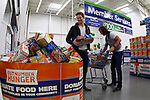 Florida Georgia Line's Brian Kelley, left, and Tyler Hubbard donate General Mills products at Sam's Club in support of Outnumber Hunger on Tuesday, March 19, 2013, in Nashville, Tennessee.  (Photo by Wade Payne/Invision for General Mills/AP Images)