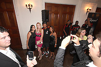 Ronaldinho of AC Milan poses with a bevy of local beauties at a reception for AC Milan at DAR Constitution Hall in Washington DC on May 24 2010.