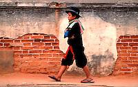 Muang Hill Tribe Boy walking the on the street in Luang Prabang, Laos