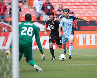 Graham Zusi (8) of Sporting Kansas City moves past Daniel Woolard (21) of D.C. United in the box during a Major League Soccer match at RFK Stadium in Washington, DC.  D.C. United tied Sporting Kansas City, 1-1.