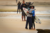 "Gabriel Medina (BRA) with his father after his heat win. THIRTEENTH BEACH, Victoria/Australia (Tuesday, April 6, 2010) - The Rip Curl Pro Bells Beach relocated to nearby Thirteenth Beach for Round 2 of competition which commenced at 9am today..Stop No. 2 of 10 on the 2010 ASP World Tour, the Rip Curl Pro completed the opening round of competition over the weekend at the primary site of Bells Beach. However, with small surf on offer at Bells and lack of contestable banks available at the secondary site of Johanna, event organizers have arranged to run today in the punchy two-to-three foot (1 metre) peaks of Thirteenth Beach..""We've seen a slight increase in surf throughout the morning and we'll be commencing competition at 9am,"" Damien Hardman, Rip Curl Pro Contest Director, said. ""It's not ideal, but it looks like it will be our best opportunity to run and we're hoping conditions improve throughout the day."".First up this morning was Bede Durbidge (AUS), 27, who defeated wildcard Stuart Kennedy (AUS), 20. The upsets of the round were the elimination of the Hobgood brothers CJ and Damien..CJ lot to Brazilian wildcard Gabriel Medina while Neco Padaratz (BRA) defeated Damien..Dane Rynolds (USA) and Jordy Smith (ZAF) both advanced to Round 3..Photo: joliphotos.com"