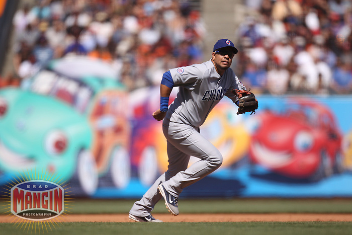 SAN FRANCISCO - AUGUST 31:  Aramis Ramirez #16 of the Chicago Cubs makes a play at third base against the San Francisco Giants during the game at AT&T Park on August 31, 2011 in San Francisco, California. Photo by Brad Mangin