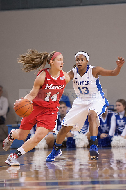 UK sophomore guard Bria Goss (right) guarding against Marist junior guard Casey Dulin (left) during the first half of the UK vs. Marist basketball game at Memorial Coliseum on Sunday, Dec. 30, 2012. Photo by Adam Chaffins | Staff