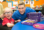 St Johnstone players visit Fairview School in Perth.....19.12.13<br /> David Wotherspoon hands out a selection box to Alfie Ashcot. Teacher Barbara Dunlop then proceeded to teach David Wotherspoon how to sign Merry Christmas to Alfie.<br /> Picture by Graeme Hart.<br /> Copyright Perthshire Picture Agency<br /> Tel: 01738 623350  Mobile: 07990 594431