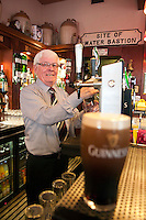 Londonderry, Derry, Northern Ireland, United Kingdom, May 2011. Hugh McDaid owner of Badger's Pub taps a draught Guinness beer.  Londonderry, also known as Derry is the only remaining completely walled city in Ireland and one of the finest examples of Walled Cities in Europe. For decades travellers stayed away from the sectarian violence, but since the end of 'The Troubles' more and more people start discoving the beauty of Belfast and the Antrim Coast Causeway. Photo by Frits Meyst/Adventure4ever.com