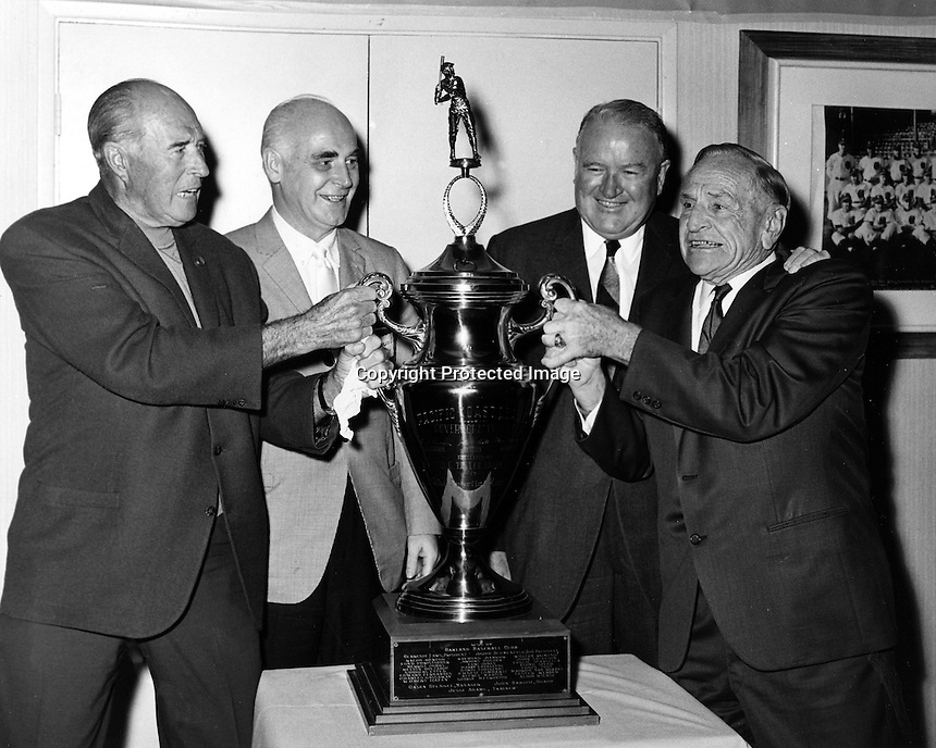 Old Baseball greats with the Pacific Coast League Governor's trophy..from the left: Lefty O'Doul, Oakland A's owner Charlie Finley, American League Commissioner Joe Cronin, and Casey Stengel. Stengel and O'Doul were opposing managers in the Coast League. (1968 photo by Ron Riesterer)