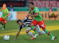 FUSSBALL  DFB POKAL        SAISON 2012/2013 SV Wacker Burghausen - Fortuna Duesseldorf  19.08.2012 Moritz Moser (li, Burghausen) gegen Ronny Garbuschewski (Duesseldorf)