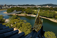 Looking out from Okayama castle towards the Korakuen garden. Okayama, Okayama Prefecture, Japan, October 7, 2015. The southern city of Okayama is well-known for its temperate climate, castle, and the beautiful traditional Korakuen gardens.