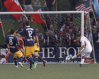 New England Revolution substitute midfielder Kelyn Rowe (11) scores. 2013 Lamar Hunt U.S Open Cup fourth round, New England Revolution (white) defeated New York Red Bulls (blue/yellow), 4-2, at Harvard University's Soldiers Field Soccer Stadium on June 12, 2013.