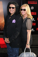 """HOLLYWOOD, LOS ANGELES, CA, USA - MAY 08: Gene Simmons, Shannon Tweed Simmons at the Los Angeles Premiere Of Warner Bros. Pictures And Legendary Pictures' """"Godzilla"""" held at Dolby Theatre on May 8, 2014 in Hollywood, Los Angeles, California, United States. (Photo by Xavier Collin/Celebrity Monitor)"""