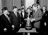 United States President John F. Kennedy presents the American Legion Merchant Marine Achievement award to US Senator Warren G. Magnuson (Democrat of Washington), behind the trophy, at the President's right, in the Cabinet Room of the White House in Washington, DC on May 22, 1963.<br /> Credit: Arnie Sachs / CNP