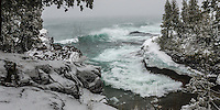 Viewing an April winter storm from the rocky shore at Presque Isle park. Marquette, MI
