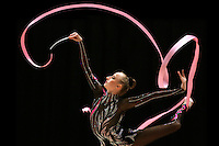 Vera Sessina of Russia (here performing with ribbon) wins Gold, Silver and Bronze in rhythmic gymnastics apparatus finals at World Games from Duisburg, Germany on July 20-21, 2005.  Event finals in rhythmic gymnastics are only held at World Games. Photo note: This image is a photo illustration. Original camera framing clips top of ribbon. Rendering close to reality done with Adobe Photoshop. (Photo by Tom Theobald)
