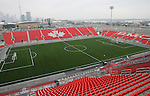 27 April 2007: A view from the broadcast booth of the stadium with downtown Toronto and Lake Ontario in the background.  BMO Field in Toronto, Ontario, Canada on the day before it was scheduled open with the inaugural home match of Major League Soccer expansion team Toronto FC.