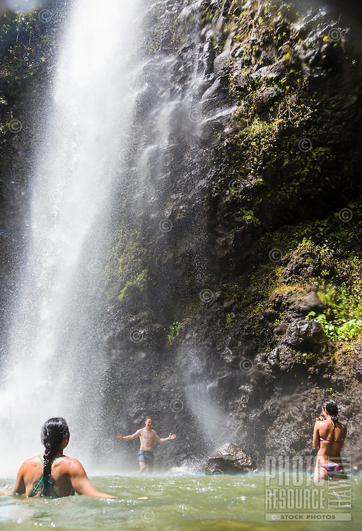 Tourists take a picture of themselves at Uluwehi Falls, Kaua'i.