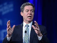 "National Harbor, MD - February 23, 2017: Governor Sam Brownback of Kansas participates in the ""States vs The State: How Governors are Reclaiming America's Promise"" forum moderated by Richard Graber during the Conservative Political Action Conference at the Gaylord Hotel in National Harbor, MD, February 23, 2017.  (Photo by Don Baxter/Media Images International)"