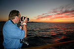 Man photographing sunset in Gulf of California
