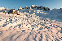 Crevasses and seracs of Explorer Glacier on top of Fox Glacier during sunset with Mt. Tasman dominating skyline, Westland Tai Poutini National Park, West Coast, UNESCO World Heritage Area, New Zealand, NZ