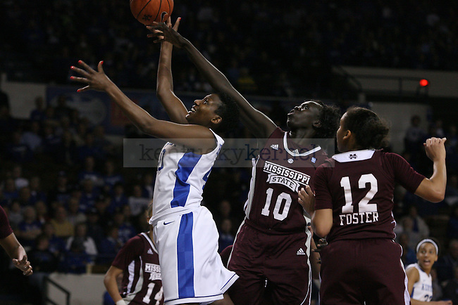UK senior forward Brittany Henderson soars past Mississippi State at Memorial Coliseum on Thursday, January 17, 2013 in Lexington, Ky.  Photo by Adam Pennavaria   Staff